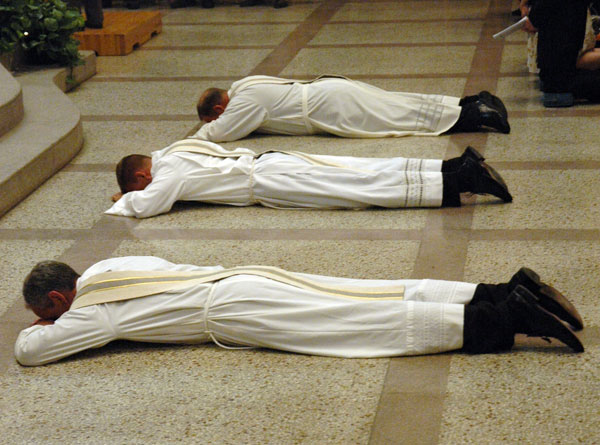 Deacons Kovatch, From Left, Nagel And Summers Lay Prostrate On The Floor Of  SS