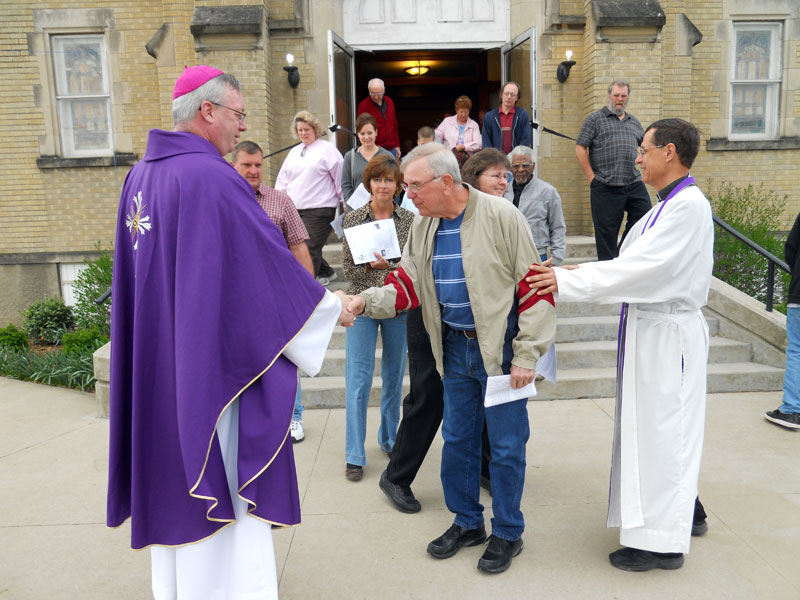 Bishop coyne commends st francis xavier parishioners assures bishop christopher j coyne and father steven schaftlein greet parishioners as they leave mass at m4hsunfo