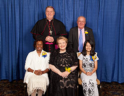 Catholic Charities Indianapolis presented four individuals with Spirit of Service Awards during an April 27 dinner in Indianapolis. Award recipients, seated from left, are Domoni Rouse, Phyllis Land Usher and Htoo Thu. Standing are Archbishop Joseph W. Tobin and award winner Tim Hahn. (Submitted photo by Rich Clark)