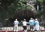 People praying at Notre Dame grotto