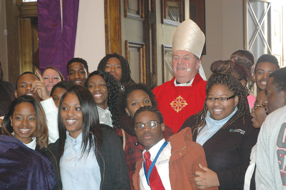 let the word of god illuminate you cardinal tells high school cardinal joseph w tobin poses for a photo members of the senior class of