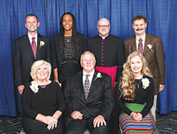 Catholic Charities Indianapolis presented four individuals and a business with Spirit of Service Awards during an April 26 dinner in Indianapolis. Award recipients, seated from left, are Karen and Don Beckwith and Grace Albertson. Standing, from left, are John Ryan, president and CEO of Hall, Render, Killian, Heath & Lyman law firm; keynote speaker Tamika Catchings; Msgr. William F. Stump, archdiocesan administrator; and award winner Gary Gadomski. (Submitted photo by Rich Clark)