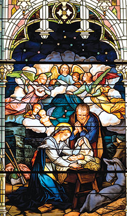 Mary and the Christ Child are depicted in this stained-glass window located in Prince of Peace Church in Madison. The feast of the Nativity of Christ, a holy day of obligation, is celebrated on Dec. 25. (Photo by Laura Jayne Gardner Photography)
