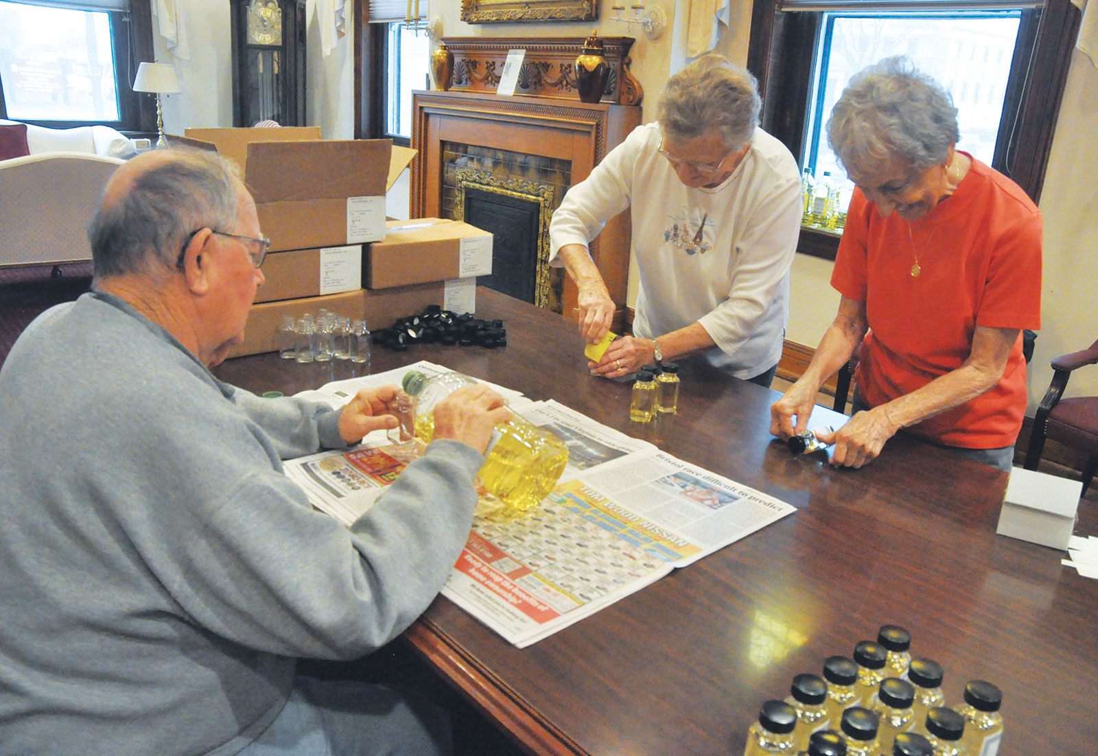 Volunteers prepare oils to be blessed at chrism Mass (April